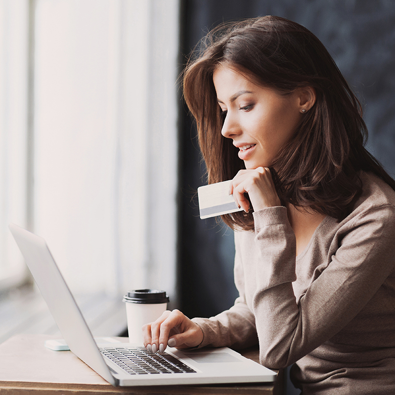 Woman Checking Card Balance Online
